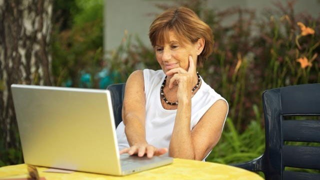 woman outside on laptop computer