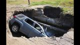 A wild sinkhole swallows a SUV, with a driver inside. How he got out…