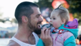 Katy man headed to record books for half-marathon run with baby