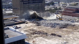 Parking garage collapses onto excavator during demolition in Upper Kirby area
