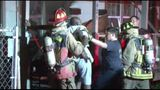 Firefighters forced to restrain man from going into burning duplex