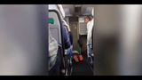 Passenger taken off plane after kicking, screaming
