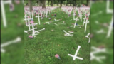 Driver plows through Memorial Day cross display