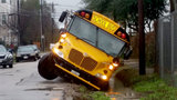 School bus driver rescued from flood waters