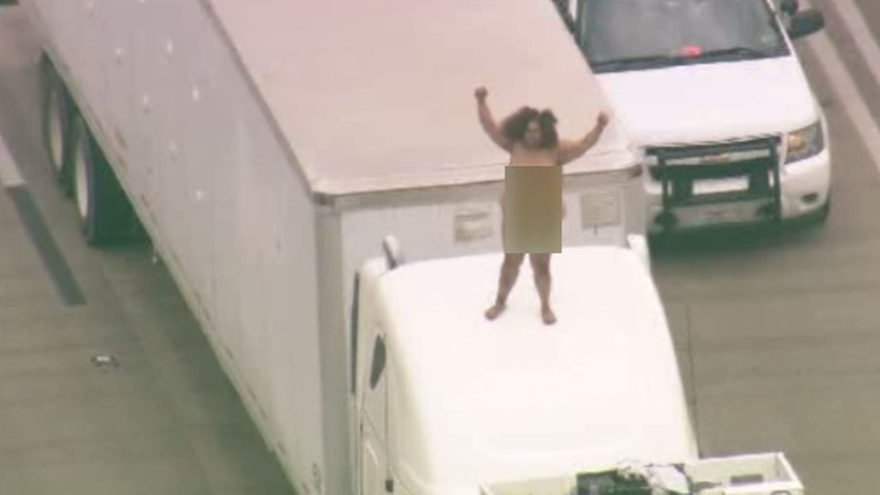 dancing naked woman on big rig causes stir, freeway backup on