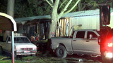 Two men escape burning mobile home