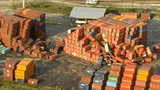 2 hurt after shipping containers fall on vehicle