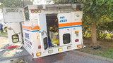Ambulance overturns after crash
