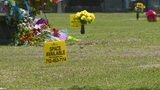 Cemetery faces criticism over signs advertising available gravesites