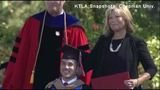 Woman gets honorary MBA with son