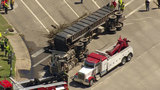 Sky 2 flies above overturned tractor-trailer in Sugar Land