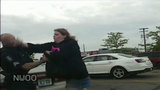 Woman punches cop in face