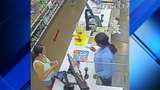 Surveillance video of people using credit cards stolen during robbery