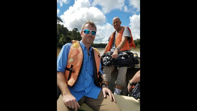 justin and allen on boat borneo_1512585600699.jpg