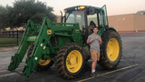 Tomball HS senior rides big green tractor to school