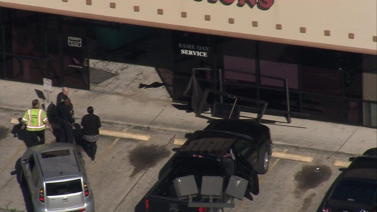 Vehicle crashes into southwest Houston dry cleaner