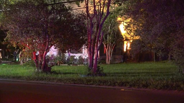 Firefighters battle massive house fire