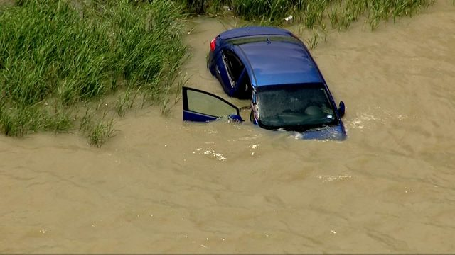Woman rescued from car after it ends up in Goose Creek