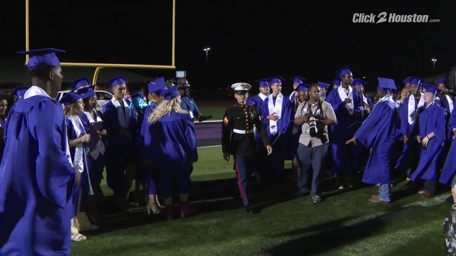 Marine surprises sister at Angleton High School graduation ceremony