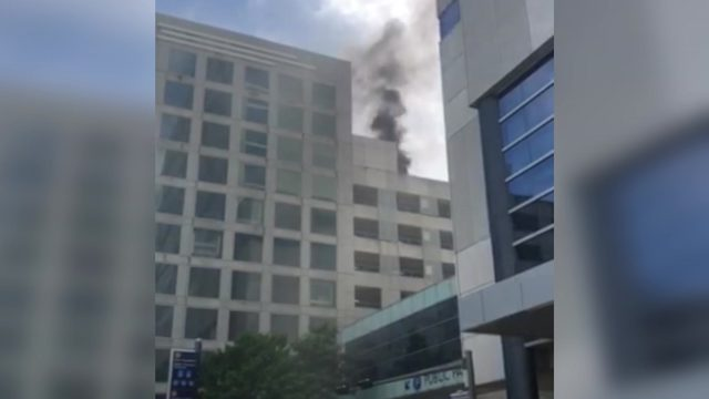Car fire causes smoke to billow from Hilton Hotel's garage in downtown Houston