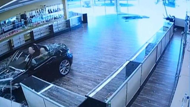 VIDEO: Woman slowly crashes BMW into medical marijuana dispensary
