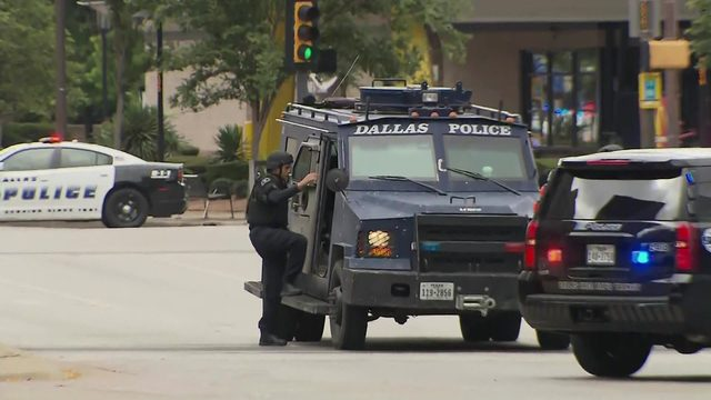 Masked gunman shot to death after opening fire in Dallas courthouse