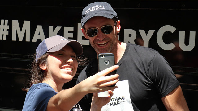 Hugh Jackman surprises fans with free coffee at Discovery Green