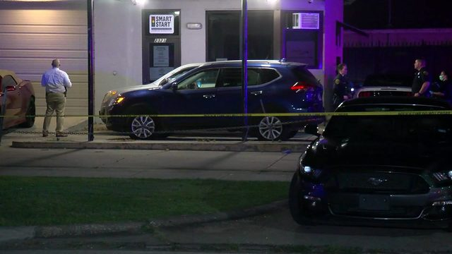 Man found shot to death in parking lot of auto business