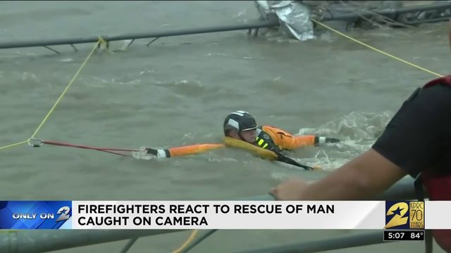 Firefighters react to rescue of man caught on camera