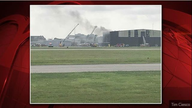 10 killed when plane crashes into hangar at Addison Airport, officials say