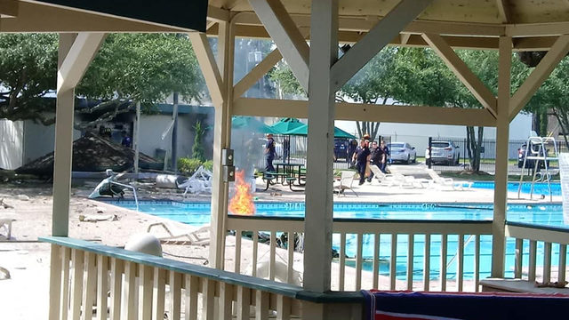 Surveillance video shows moment small plane crashes into Katy community center
