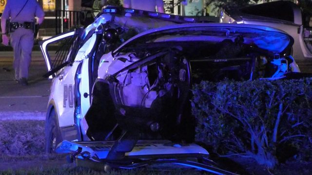 League City officer flown to hospital after crashing into sports car