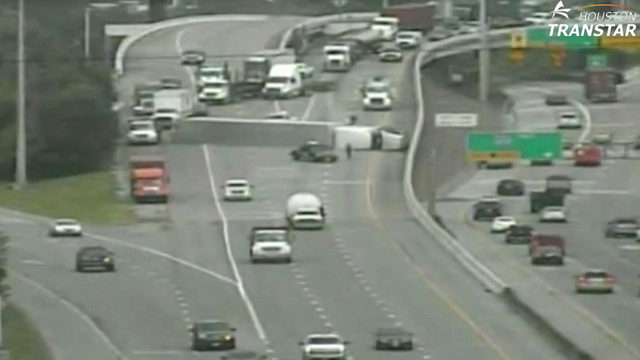 Overturned tractor-trailer blocks nearly all of SH 225 at 610 Loop