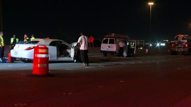 Off-duty officer hit while helping crash victim on Highway 290