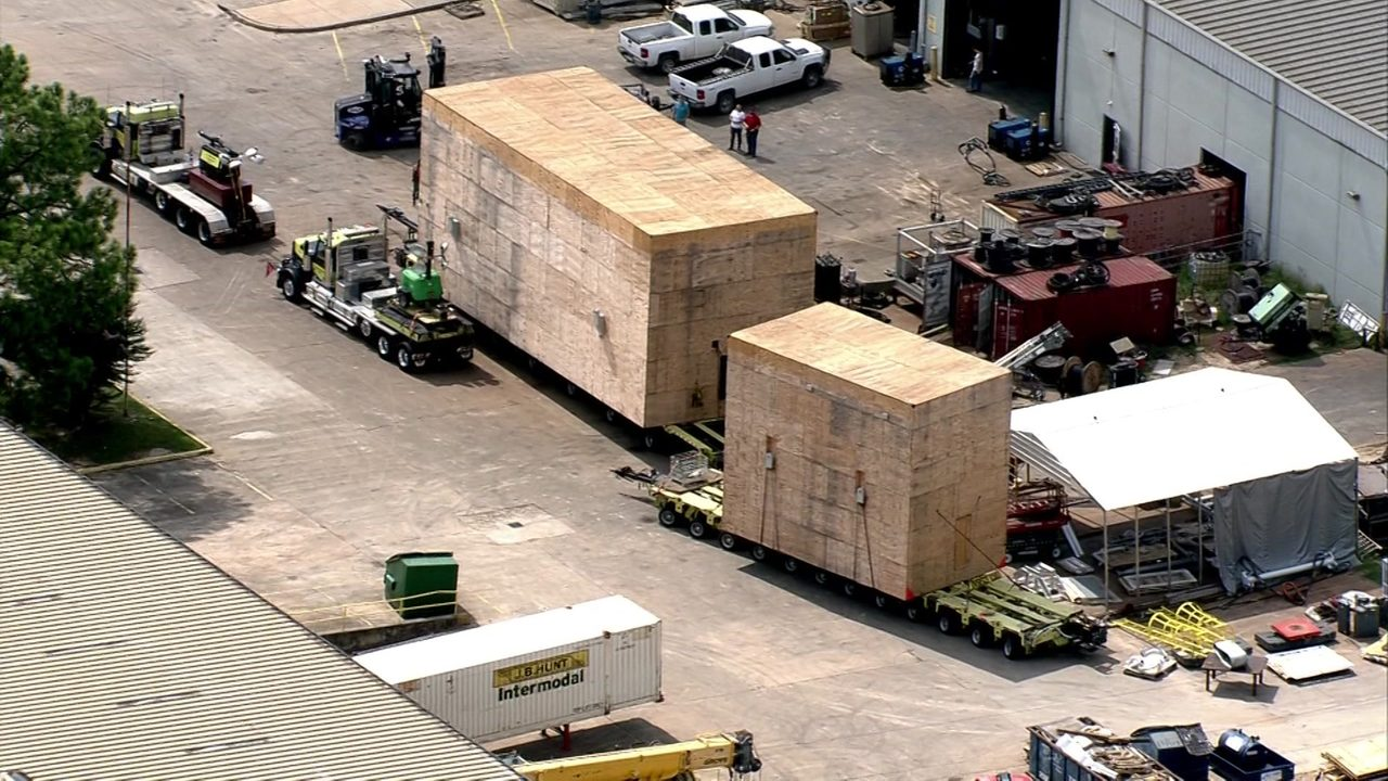 Massive crates being moved through Houston make it to their