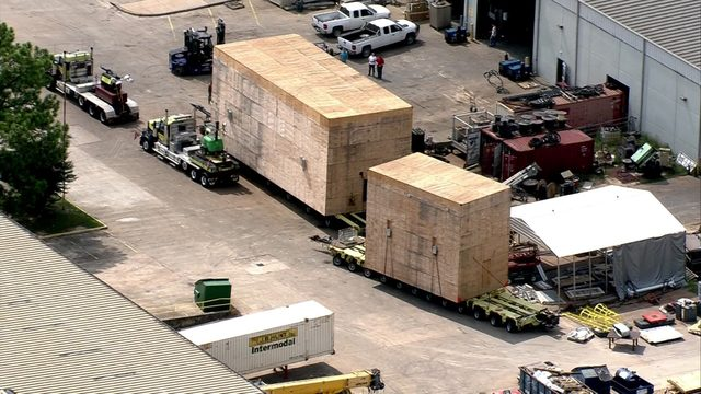 Massive crates being moved through Houston behind schedule