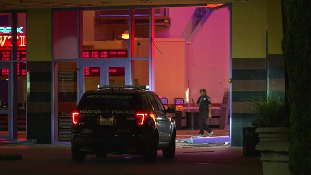 Thieves drive van into movie theater, steal ATM