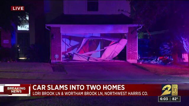 Car slams into two homes