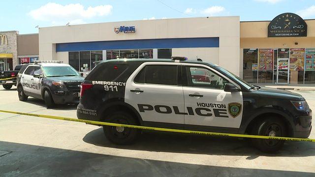 Two men shot in busy parking lot