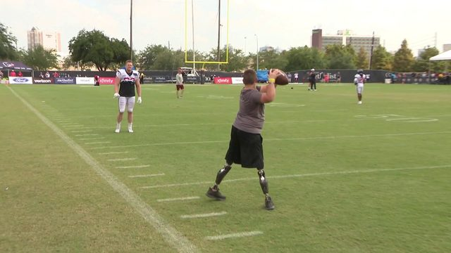 Calder Hodge plays catch with J.J. Watt
