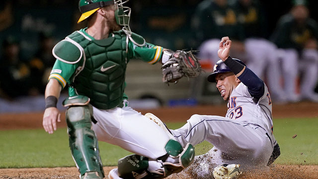 A's edge Astros 3-2 in 13 to inch closer in playoff chase