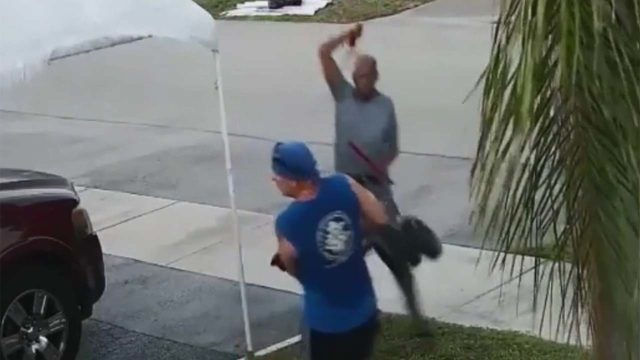 VIDEO: Sword-wielding man attacks over trash-pile wheelbarrow