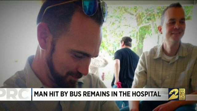 Man Hit by Bus Remains in the Hospital