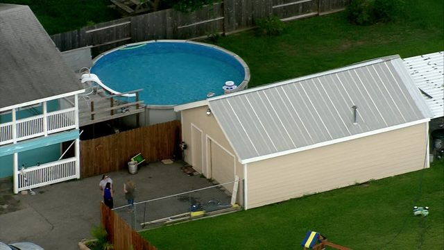 1-year-old dies after being found face down in neighbor's pool, police say