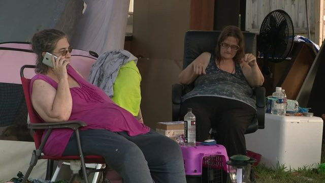 Sisters living on front porch of rental property after being evicted…