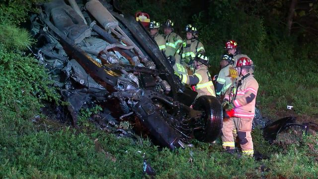 Driver rescued after truck rolls off freeway, lands upside-down in embankment