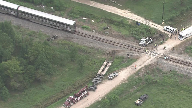 At least 18 people injured when Amtrak train, 18-wheeler collide in…