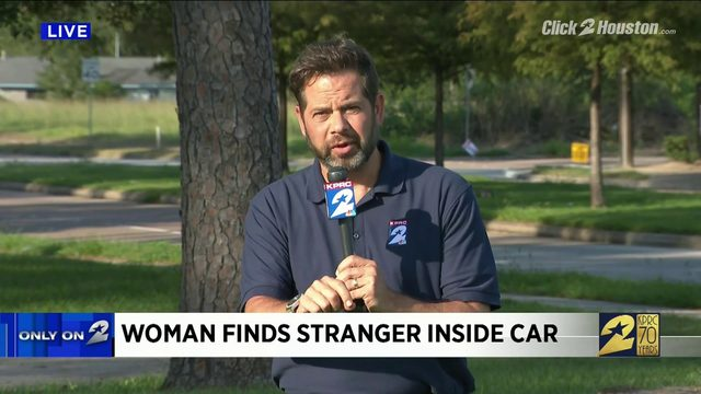Woman finds stranger inside car