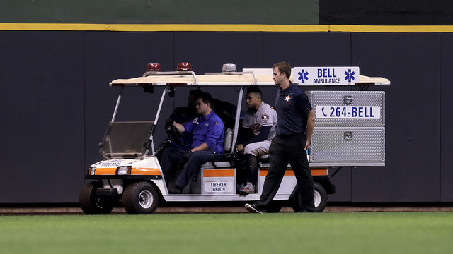 George Springer exits game after hitting head on outfield wall