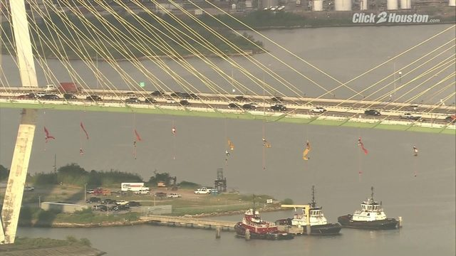 Greenpeace protesters hang from Fred Hartman bridge